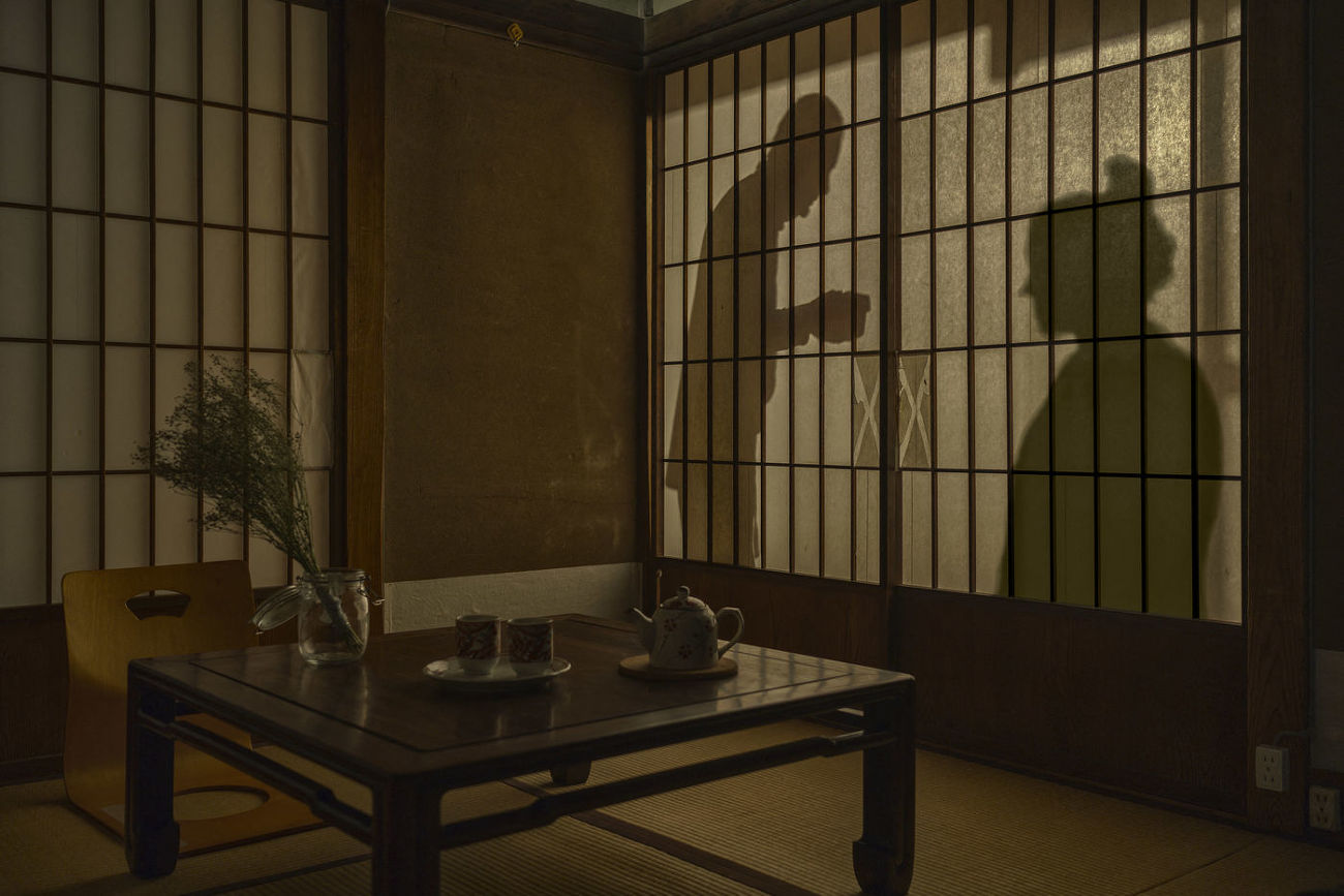 JAPAN - SILHOUETTE THROUGH A RICE PAPER DOOR IN A RYOKAN