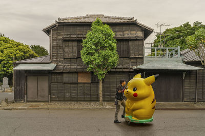 JAPAN - MAN PUSHING A BIG PIKACHU